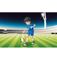 A boy at the field using the ball with the flag of vector image vector image