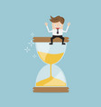 businessman sitting on hourglass business time vector image