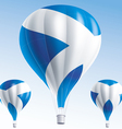 Hot balloons painted as scottish flag vector image
