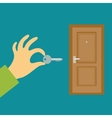 Hand with a key opens or closes the door Flat vector image
