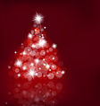 Lighted up Christmas tree with many lensflares on vector image