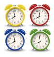 Yellow blue green red retro alarm clocks vector image