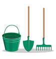 gardening bucket green shovel and rake on white vector image