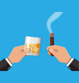 glass of whiskey with cigar in hand vector image