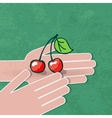 two hands hold a ripe cherry vector image vector image
