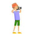young boy holding photo camera and taking pictures vector image