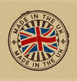 made in the uk stamp on wooden background vector image vector image