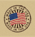made in the usa stamp on cardboard background vector image