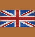 uk flag painted on old wooden planks background vector image