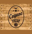 cognac label on wooden background vector image