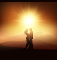 silhouette of a couple in a sunset landscape vector image