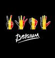 hands on Belgium flag background lettering vector image