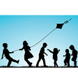 Group of children silhouettes with a kite outdoor vector image