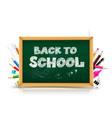 calligraphy title text back to school over green vector image