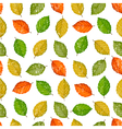 Grunge seamless pattern with colored leaves vector image