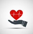 Hand holding a human heart vector image vector image