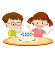 kids blowing cake on birthday vector image
