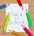 Back to school message with pencils on paper sheet vector image