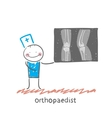 orthopaedist shows an X-ray vector image vector image