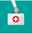 first aid kit in the doctors hands vector image