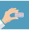 doctor holding blister pack of pills vector image