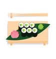 maki sushi with avocado served on wooden board vector image