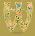 yellow letter w with floral decor and necklace vector image