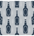 Seamless pattern with beer bottles vector image