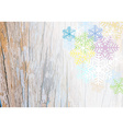 wooden plank background with colorful snowflake vector image