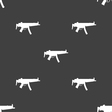 machine gun icon sign Seamless pattern on a gray vector image