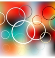Colored circles on the blurred background vector image