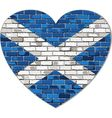 Scotland flag on a brick wall in heart shape vector image
