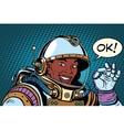 African American astronaut OK gesture vector image