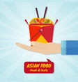 hand giving box with wok noodles asian food vector image