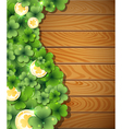 Magic clover on wooden background vector image