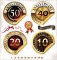 Set of golden anniversary labels vector image