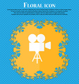 Video camera icon Floral flat design on a blue vector image