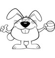 cartoon easter bunny holding an easter egg vector image