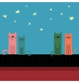 Colored cats sitting on the roof vector image