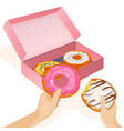 delicious donuts in cardboard box and human hands vector image
