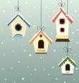Abstract hanged bird house set in snowfall vector image