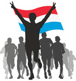 Winner with the Luxembourg flag at the finish vector image