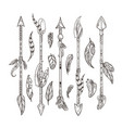 decorative arrows and feathers set in boho style vector image