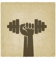 hand with dumbbell fitness symbol on old vector image