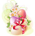 flowers and colored eggs for easter vector image