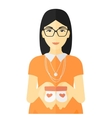 Pregnant woman with baby booties vector image