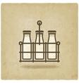 milk bottles in basket on old background vector image