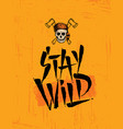 stay wild skull wearing coonskin hat with two vector image