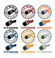 grunge kettlebell in the hand fitness emblems vector image