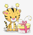 greeting card cute tiger with gift vector image
